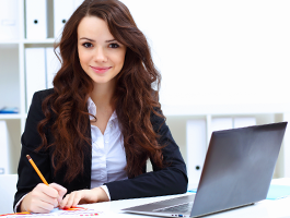 Business Woman Holding a Pencil with Black Laptop